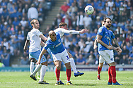 Portsmouth Forward, James Vaughan (32) wins a header during the EFL Sky Bet League 1 match between Portsmouth and Coventry City at Fratton Park, Portsmouth, England on 22 April 2019.
