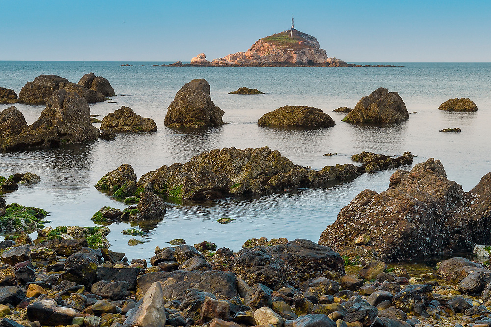 """Landscape of the coastline of Yangma island, prefecture Yantai, Shandong, China. Yangma Island is situated by the Yellow Sea and it is called """"the pearl in the sea""""."""