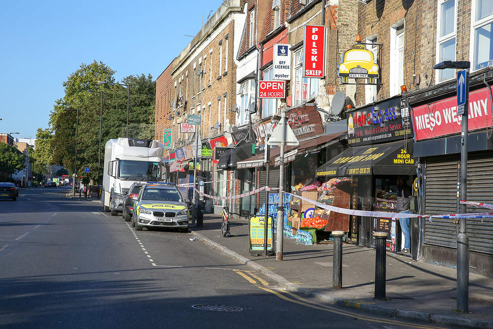 © Licensed to London News Pictures. 18/09/2019. London, UK. The scene on Lordship Lane near Wood Green underground station in North London following a shooting at 9.50pm on Tuesday, 17 September. A short time later, a 46-year-old woman and a 31-year-old man presented themselves at hospital. The woman had sustained a gunshot injury and her condition has been assessed as critical. The condition of the 31-year-old man is not life-threatening or life-changing. He is thought to have sustained a minor gunshot injury. Photo credit: Dinendra Haria/LNP