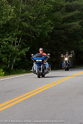 Riding to the Broken Spoke during Laconia Motorcycle Week. Laconia, NH, USA. June 14, 2015.  Photography ©2015 Michael Lichter.