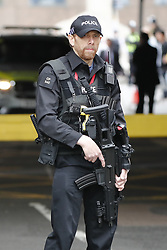 © Licensed to London News Pictures. 10/04/2017. London, UK. The funeral cortege carrying the coffin of policeman Keith Palmer arrives at at Southwark Cathedral in London ahead of his funeral. PC Palmer was murdered just inside the gate by Westminster attacker Khalid Masood - an attack in which he also killed four people on Westminster Bridge.  Photo credit: Tolga Akmen/LNP