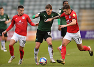 Plymouth Argyle midfielder Conor Grant (15) in action with Crewe Alexandra midfielder Owen Dale (19) and Crewe Alexandra defender Luke Offord (17) during the EFL Sky Bet League 1 match between Plymouth Argyle and Crewe Alexandra at Home Park, Plymouth, England on 16 January 2021.