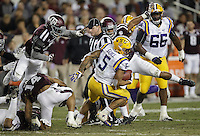 LSU running back Derrius Guice (5) spins out of a tackle by Aggie defenders during the second quarter of an NCAA college football game Thursday, Nov. 24, 2016, in College Station, Texas. (Sam Craft/The Eagle)