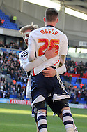 Bolton Wanderer's Joe Mason celebrates with teammate Tim Ream after scoring his sides second goal. Skybet championship match, Bolton Wanderers v Blackburn Rovers at the Reebok Stadium in Bolton, England on Saturday 1st March 2014.<br /> pic by David Richards, Andrew Orchard sports photography.
