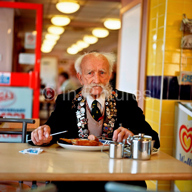 Pat a regular customer at Jacks of Bagshot on the 18th July 2008 in Bagshot in the United Kingdom. Pat used to work at Jacks Cafe, doing odd jobs. Now retired, he returns to the cafe where he enjoys a free daily lunch thanking him for years of service.