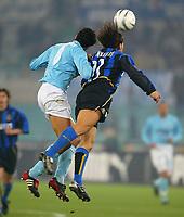 Rome December 7 2002 - Italian Championship<br />Lazio - Inter 3-3<br />Contrasto aereo tra Fabio Cannavaro e Bernardo Corradi