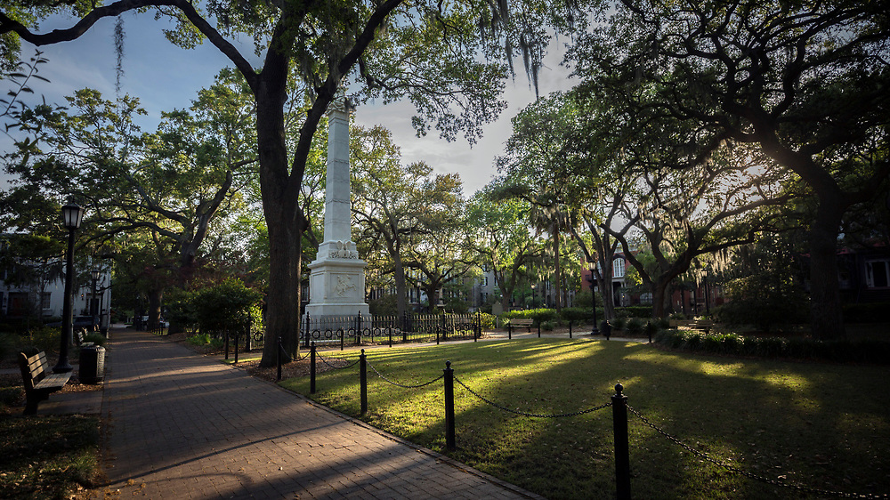 SAVANNAH, GA - APRIL 6, 2020: World famous Monterey Square and and the Pulaski monument would normally be bustling with visitors walking through Savannah's Landmark Historic District. Monterey Square and the nearby Mercer House, right, was one of the central characters of the best selling book Midnight in the Garden of Good and Evil. (AJC Photo/Stephen B. Morton)