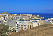 Apartment housing property development at coastal resort, Marsalforn, island of Gozo, Malta