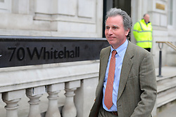 © Licensed to London News Pictures. 22/03/2019. London, UK. Oliver Letwin MP leaves the Cabinet Office. The EU27 have agreed to Prime Minister Theresa May's request for a short extension to the deadline for leaving the European Union, offering two new deadlines depending on whether she is able to pass her deal next week. Photo credit: Rob Pinney/LNP