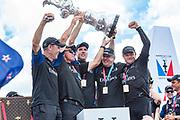 The Great Sound, Bermuda, 26th June 2017. Emirates Team New Zealand COO Kevin Shoebrdge, CEO Grant Dalton, Helmsman Peter Burling, Principal Matteo de Nora and skipper Glenn Asby hold aloft the America's Cup.