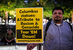 August 25, 2017 - New York City, New York, United States of America - About fifty New Yorkers protested against and strategized for the removal of the monument to explorer Christopher Columbus, who is widely credited with the discovery of the Americas.  People of color, Native Americans, and immigrants see this as the beginning of the wave of European racism, subjugation, and ultimately, white supremacy and slavery in North America.  A religious ritual was held by Native Americans in attendance. (Credit Image: © Sachelle Babbar via ZUMA Wire)