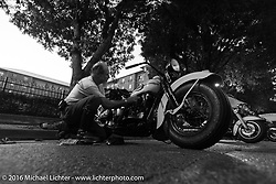 Working on a Harley-Davidson Knucklehead in the street after a hosted stop at Coker Tires in Chattanooga, Tennessee after the finish of stage 3 of the Motorcycle Cannonball Cross-Country Endurance Run, which on this day ran from Columbus, GA to Chatanooga, TN., USA. Sunday, September 7, 2014.  Photography ©2014 Michael Lichter.