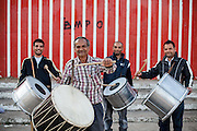 """Father Abdush (front) and his sons Mersid (left), Erdal (right) and Ergul (3rd left) during a drum session on a stage in front of the """"House of Culture"""" in Delcevo, Macedonia. The Roma family - father and his 3 sons - are well know for their drum perfomances and also they build their drums themselves."""