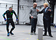 """© Licensed to London News Pictures. 04/04/2013. London, UK Actor Matt cross gestures whilst Boris Johnson the Mayor of London, visits Ealing studios today, 4th April 2013, where he announced his plans to boost London's TV, Animation and Film industries, capitalising on the new tax relief brought in by the Chancellor (from 1st April 2013) to bring major jobs and investment to the capital. He toured the Studios and spent time in the """"Imaginarium"""", where he had a go at mastering 'performance capture'. . Photo credit : Stephen Simpson/LNP"""