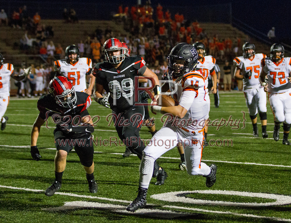 Cade Horton (#14) keeps the ball to gain yards for a first down.