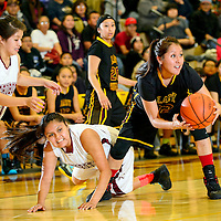 020714  Adron Gardner/Independent<br /> <br /> Tohatchi Cougar Shania Yazzie (12), right, secures a possession in Rehoboth Friday.