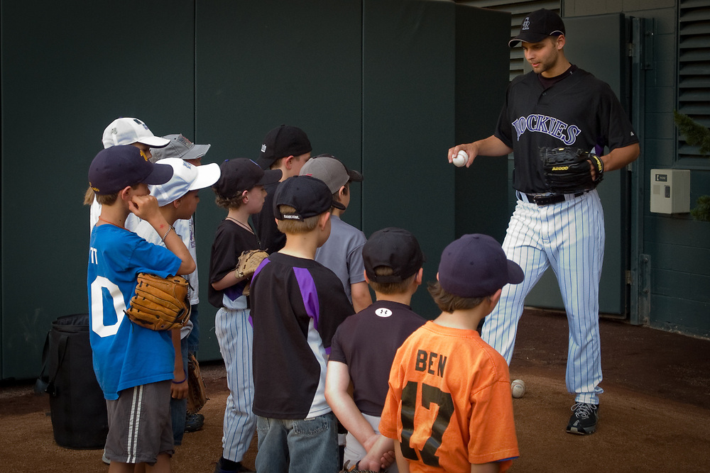 itching lessons for the Rockies Rookies Kids Club of the Colorado Rockies Major League Baseball team gather yearly at Coors Field for a free Back-To-Basics Clinic to develop their skills.