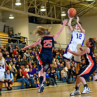 121812  Adron Gardner<br /> <br /> Miyamura Patriot Presleigh Smiley Shoots over the Aztec Tigers  in Gallup Tuesday.