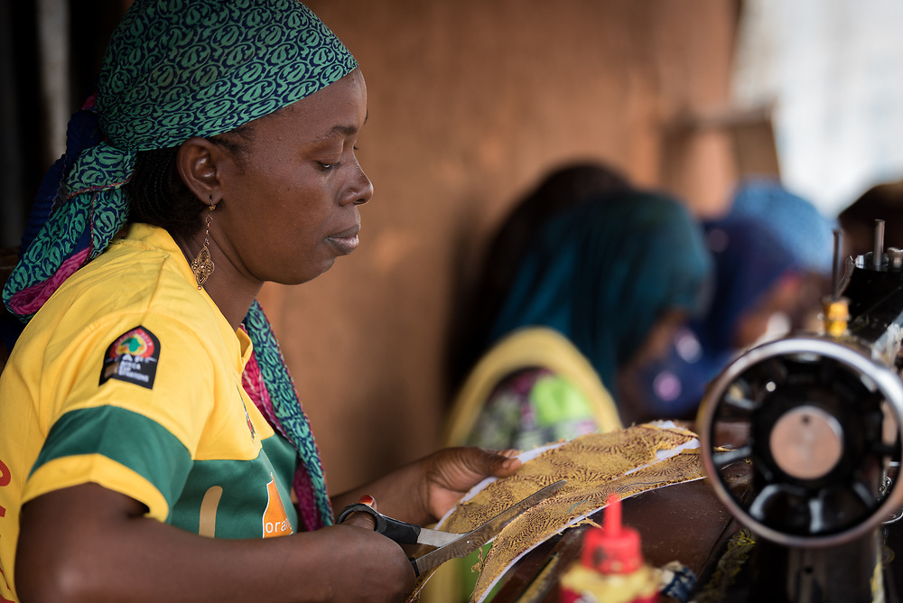 3 June 2019, Djohong, Cameroon:  Kaltoumi Chehou works at her shop in the Borgop refugee camp. She is currently training five young women at her shop, as part of a vocational training effort by the Lutheran World Federation's World Service programme, intended to help particularly young refugees make an income. The Borgop refugee camp is located in the municipality of Djohong, in the Mbere subdivision of the Adamaoua regional state in Cameroon. Supported by the Lutheran World Federation since 2015, the camp currently holds 12,300 refugees from the Central African Republic.