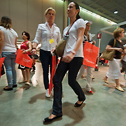 MILAN, ITALY - JUNE 11:  Customers rapidly approach the stands on  the day of the opening to the public of the 10th Convivio on June 11, 2010 in Milan, Italy. Convivio is Italy's most high profile charity sale to raise money for ANLAIDS the national association for the fight against AIDS  (Photo by Marco Secchi/Getty Images)