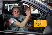 Black taxi cab drivers protest in Whitehall, central London, objecting to a new online booking and journey fare app called Uber. The app works out the cost of journeys and cab drivers say it is the same as using a taxi meter, which only black cabs are legally entitled to use. The London Taxi Driver Association (LTDA) also said part of the demonstration was about highlighting the length of training - between four and seven years - taxi drivers undergo before being licensed. During the protest roads were gridlocked around Parliament Square, Whitehall and Trafalgar Square in the capital's West End. .