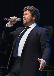 © Licensed to London News Pictures. 01/09/2013. London, UK Michael Ball performs with the Royal Philharmonic Concert Orchestra at An Evening of Gershwin at Live by the Lake in Hampstead Heath in London on the 1st September 2013. Photo credit : Stephen Simpson/LNP