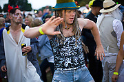 A man dances in a field to a mobile sound system at the Standon Calling Festival in Hertfordshire, UK.<br /> Standon Calling is a small independent festival set among the hills in Herfordshire that showcases World Music, Indie Music and dance Music. It is one of the new, small and quirky boutique festivals which have become popular in the UK.