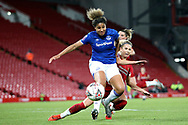 Liverpool women forward Kirsty Linnett (24) and Everton women defender Gabrielle George (6) go into the challenge during the FA Women's Super League match between Liverpool Women and Everton Women at Anfield, Liverpool, England on 17 November 2019.