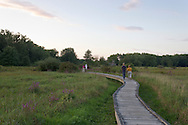 Vernon, New Jersey - People walk along the Pochuck Boardwalk section of the Appalachian Trail on Aug. 28, 2012. The trail includes the Pochuck Quagmire Bridge, a wooden suspension bridge over the Pochuck Creek.