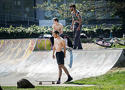 © Licensed to London News Pictures. 10/04/2020. London, UK. A group of youths use the skate park in Wandle Park, Croydon. The government has warned that people must continue to follow the public health guidance on social distancing over the Easter weekend. Photo credit: Peter Macdiarmid/LNP