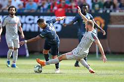 July 28, 2018 - Ann Arbor, Michigan, United States - Ragnar Klavan (17) of Liverpool goes to steal the ball from Alexi Sanchez (7) of Manchester United during an International Champions Cup match between Manchester United and Liverpool at Michigan Stadium in Ann Arbor, Michigan USA, on Wednesday, July 28,  2018. (Credit Image: © Amy Lemus/NurPhoto via ZUMA Press)