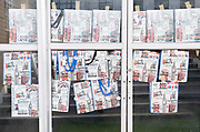 A window display of fading London-themed shopping bags on sale to an absent tourism market, in the City of London, the capital's financial district, on 10th February 2021, in London, England.