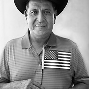 New American: Esteban Orozco Infante, 61, naturalized as a US Citizen moments earlier, said he wanted a voice after years of hard work in this country.