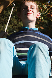Young man with autism on swing. Cleared for Mental Health issues.