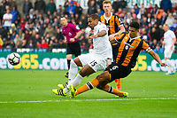 Football - 2016 / 2017 Premier League - Swansea City vs. Hull City<br /> <br /> Wayne Routledge tackled by Curtis Davies of Hull City-- at the Liberty Stadium.<br /> <br /> COLORSPORT/WINSTON BYNORTH