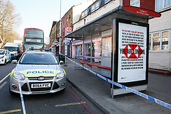 © Licensed to London News Pictures. 29/03/2019. London, UK. Crime scene on Tottenham High Road at the junction with Talbot Road in north London where a man in his 30s was found with stab wounds at a bus stop just after 6.30am this morning. Photo credit: Dinendra Haria/LNP