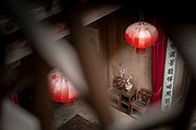 Chinese style architecture and lanterns inside of Pigs Inn, Bishan, Anhui Province, China