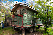 Small green house on wheels. Dawson City was the center of the Klondike Gold Rush (1896–99), after which population rapidly declined, in Yukon, Canada. Dawson City shrank further during World War II after the Alaska Highway bypassed it 300 miles (480 km) to the south using Whitehorse as a hub. In 1953, Whitehorse replaced Dawson City as Yukon Territory's capital. Dawson City's population dropped to 600–900 through the 1960s-1970s, but later increased as high gold prices made modern placer mining operations profitable and tourism was promoted. In Yukon, the Klondike Highway is marked as Yukon Highway 2 to Dawson City.