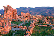MOROCCO, ROMAN HISTORY Volubilis, 1-3C AD, Roman city in the Roman province of Mauretania Tingitana; view of Caracalla's Arch and Basilica