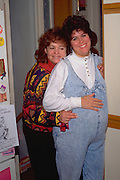 Aunt embracing pregnant niece age 48 and 26.  WesternSprings Illinois USA