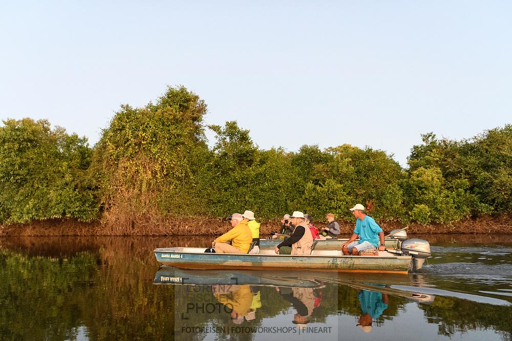 Tourists in a boat on the Rio Negro, Pantanal, Mato Grosso do Sul, Brazil