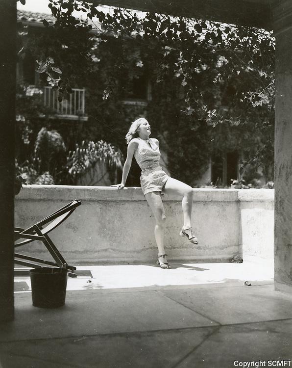 1950 Ladies sunbathe at the Hollywood Studio Club on Lodi Pl.