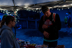 January 19, 2019 - Southern Pines, North Carolina, US - Jan. 19, 2019 - Southern Pines N.C., USA - Aaron Dacey, Smithfield, North Carolina, stops by the aid station at the start/finish line after completing a lap during the 10th Annual Weymouth Woods 100km ultra marathon at the Weymouth Woods Nature Preserve. Runners needed to complete 14 laps of the 4.47 mile course for 62.58 miles in under the 20-hour time allotment. (Credit Image: © Timothy L. Hale/ZUMA Wire)