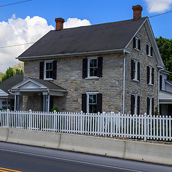 Strasburg, PA, USA - May 23, 2018: A stone house located at the Amish Village in Lancaster County, a popular tourist attraction.
