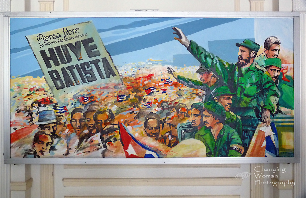 A wall-sized painting displayed in the Museum of the Revolution, Havana, Cuba, depicts the 1 Jan 1959 announcement of ousted dictator Batista's flight from the country. The free press's banner headline, a large image at the left of the painting, is balanced by the large, detailed figures at the right of victorious General Fidel Castro and his military leaders greeting the liberated Cuban people.