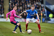 Queens Park Rangers Midfielder, Josh Scowen (11) and Portsmouth Midfielder, Dion Donohue (17) during the The FA Cup fourth round match between Portsmouth and Queens Park Rangers at Fratton Park, Portsmouth, England on 26 January 2019.