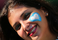 An Argentina female fan with a  painted face