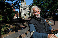 Ken Cullum relaxes on a bench in Central Park in New Britain, Conn.