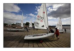 The new slipway making it easier for competitors to launch from Largs...Opening races in breezy conditions for the Laser Radial World Championships, taking place at Largs, Scotland GBR. ...118 Women from 35 different nations compete in the Olympic Women's Laser Radial fleet and 104 Men from 30 different nations. .All three 2008 Women's Laser Radial Olympic Medallists are competing. .The Laser Radial World Championships take place every year. This is the first time they have been held in Scotland and are part of the initiaitve to bring key world class events to Britain in the lead up to the 2012 Olympic Games. .The Laser is the world's most popular singlehanded sailing dinghy and is sailed and raced worldwide. ..Further media information from .laserworlds@gmail.com.event press officer mobile +44 7775 671973  and +44 1475 675129 .