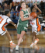 Minisink Valley's Deonna Gould, center, drives between Nina Johnson, left, and Shanice Tharkur during a Class AA state tournament game on March 10, 2006, at Pace University in Pleasantville. Minisink Valley lost the game 42-32.